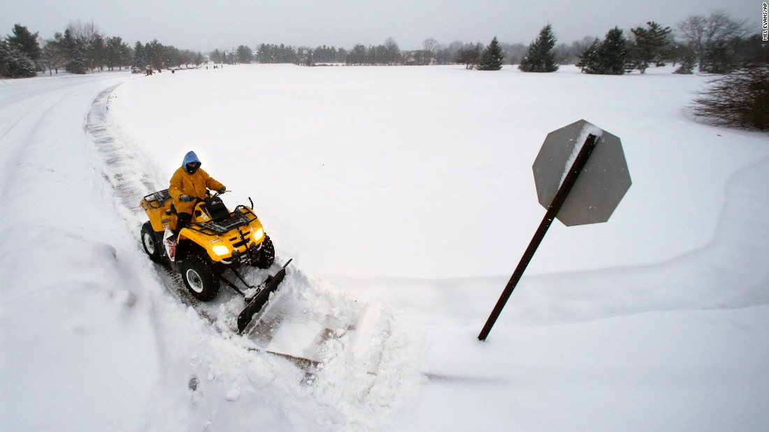 A worker clears snow in Newtown, Pennsylvania, on January 27.