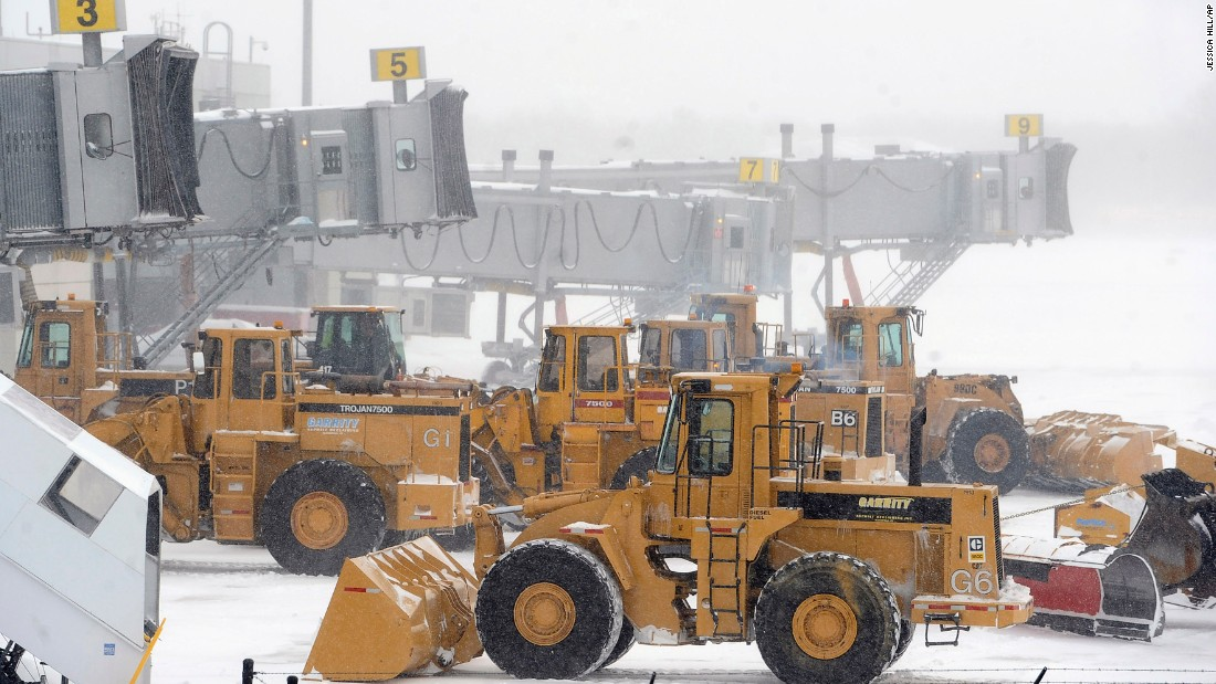 Plows line up at airplane gates at Bradley International Airport in Windsor Locks, Connecticut, on January 27.