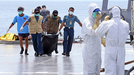 Searchers have so far retrieved 70 bodies from the Java Sea.