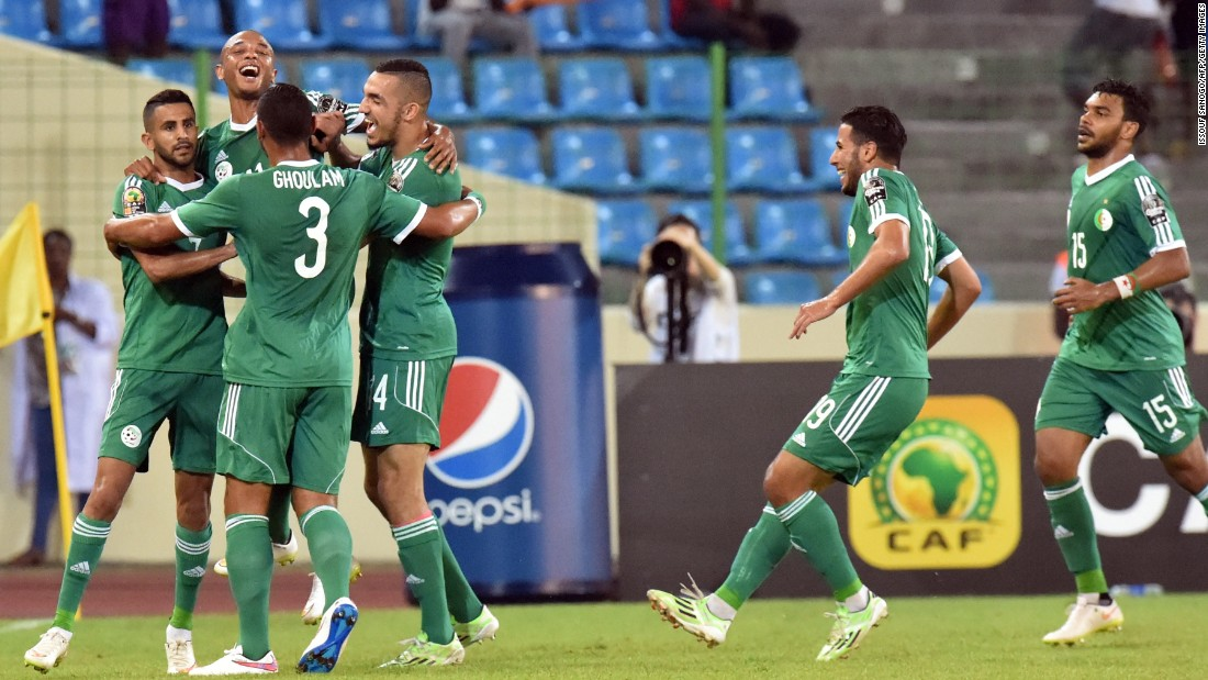 Algeria players celebrate after Riyad Mahrez opened the scoring in their country's Group C AFCON fixture against Senegal.