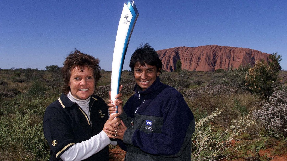 Goolagong Cawley, pictured in front of Uluru, is proud of her Aboriginal heritage.