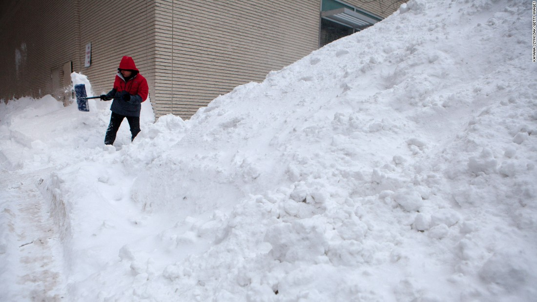 Workers continue snow removal efforts in the Back Bay neighborhood of Boston on January 28.