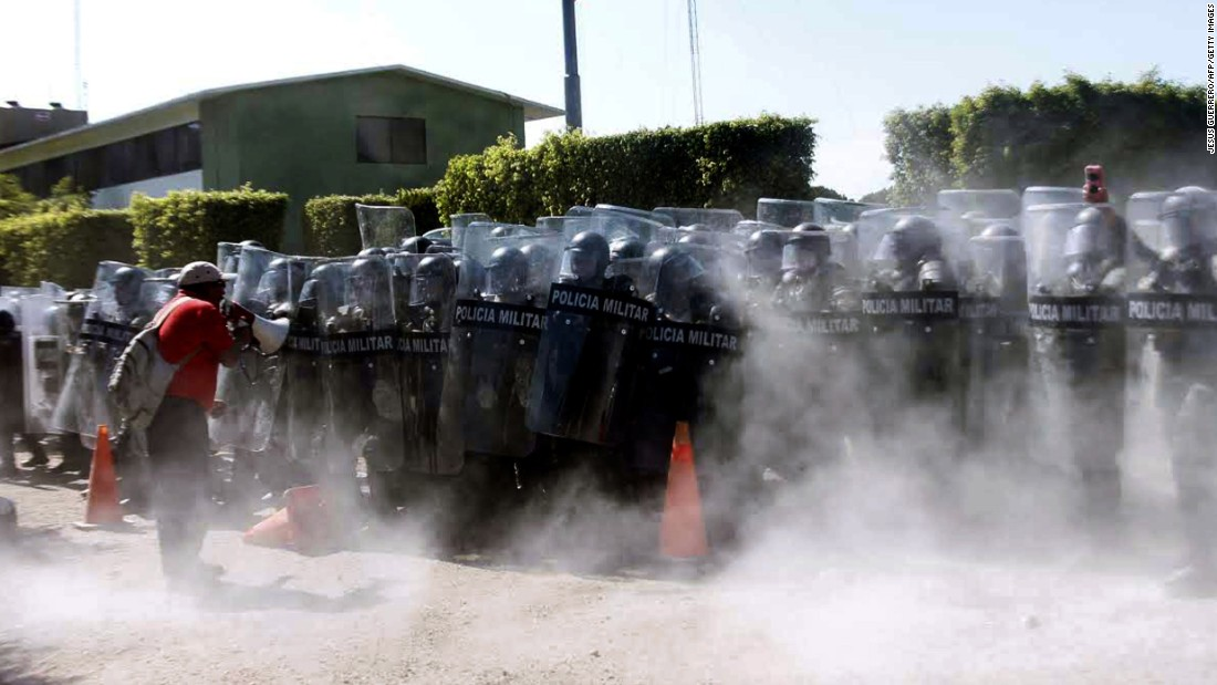 Military police spray tear gas during a protest in Iguala, Mexico, on Monday, January 12.
