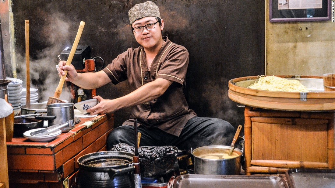 Danzai noodles were originally sold out of buckets on a bamboo pole slung over a shoulder. Today, a chef in Du Xiao Yue cooks up noodles while seated on a stool.