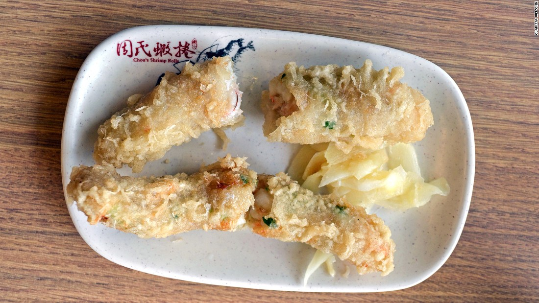 Shrimp rolls are a Taiwanese rendition of Japanese tempura, except the shrimps are wrapped in caul fat and stuffed with scallions before they're deep fried.