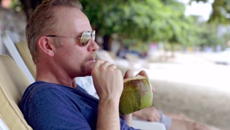 "Morgan Spurlock recuperates on the beach Thailand, for an episode of CNN's ""Inside Man"" on medical tourism."