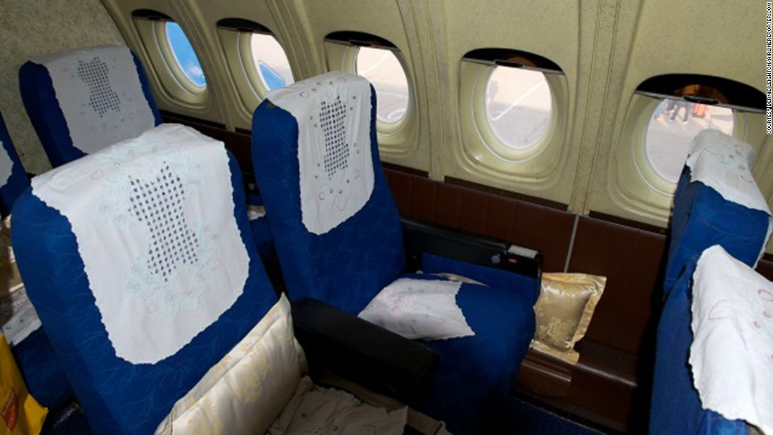 If you were flying First Class on Air Koryo, your seat might look something like this -- with speckled, linoleum-like walls and tinted Bakelite window shades.