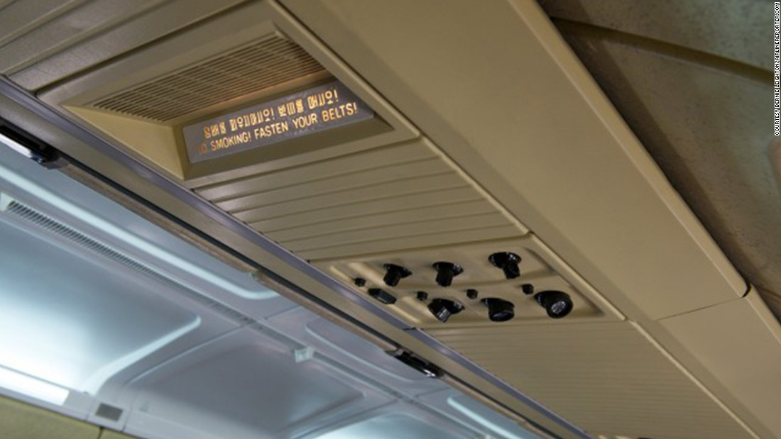 Overhead displays on Air Koryo's IL-62s are labeled in English as well as Korean.