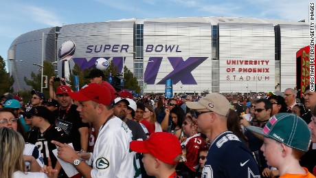 Caption:GLENDALE, AZ - JANUARY 25: Fans outside the University of Phoenix Stadium before the 2015 Pro Bowl at University of Phoenix Stadium on January 25, 2015 in Glendale, Arizona. (Photo by Christian Petersen/Getty Images)