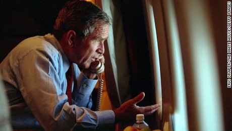 President George W. Bush speaks to Vice President Dick Cheney by phone aboard Air Force One on September 11, 2001.