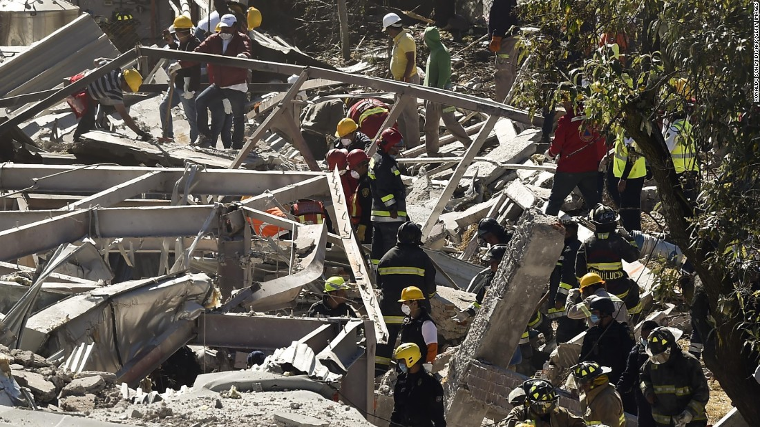 Rescue workers climb through the rubble left by the explosion. A truck was supplying gas to the hospital when apparently a hose burst and the resulting leak caused an explosion, Mexico City Mayor Miguel Angel Mancera said.
