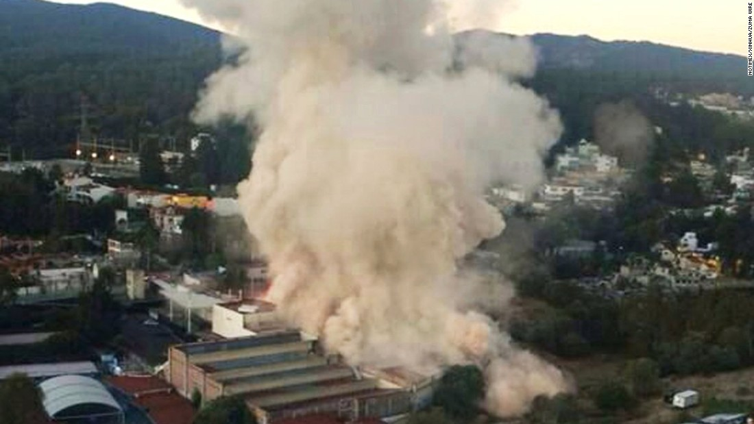 Smoke rises from the site of the explosion.