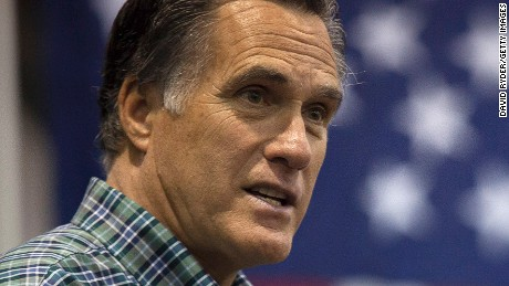 ANCHORAGE, AK - NOVEMBER 03: Former Massachusetts Gov. Mitt Romney addresses the crowd during a rally for Republican Senate candidate Dan Sullivan at a PenAir airplane hangar on November 3, 2014 in Anchorage, Alaska. The U.S. Senate race in Alaska between incumbent Democratic Sen. Mark Begich and Republican candidate Dan Sullivan continues to be closely contested. (Photo by David Ryder/Getty Images)