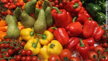 Fresh fruit and vegetables, including pears, tomatoes and bell peppers, lie on display at the Netherlands hall at the 2011 Gruene Woche agricultural trade fair at Messe Berlin on January 21, 2011 in Berlin, Germany. The trade fair comes on the heels of a dioxon scandal in Germany that led to the recent quarantine of approximately 6,000 farms. (Photo by Sean Gallup/Getty Images)