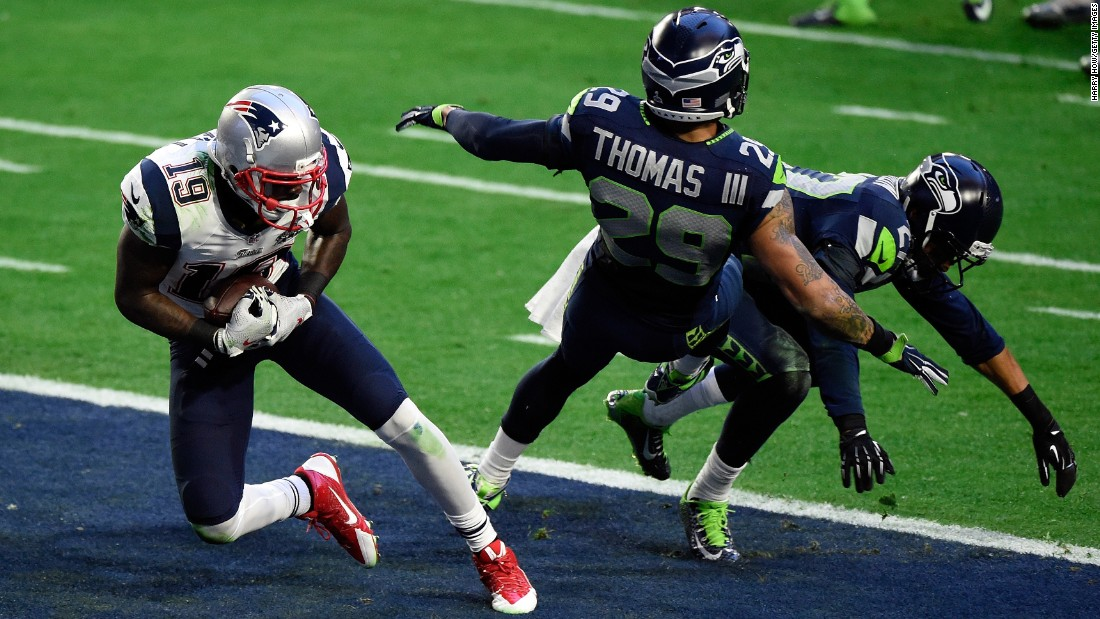 LaFell pulls in the touchdown pass as two Seattle defenders collide.