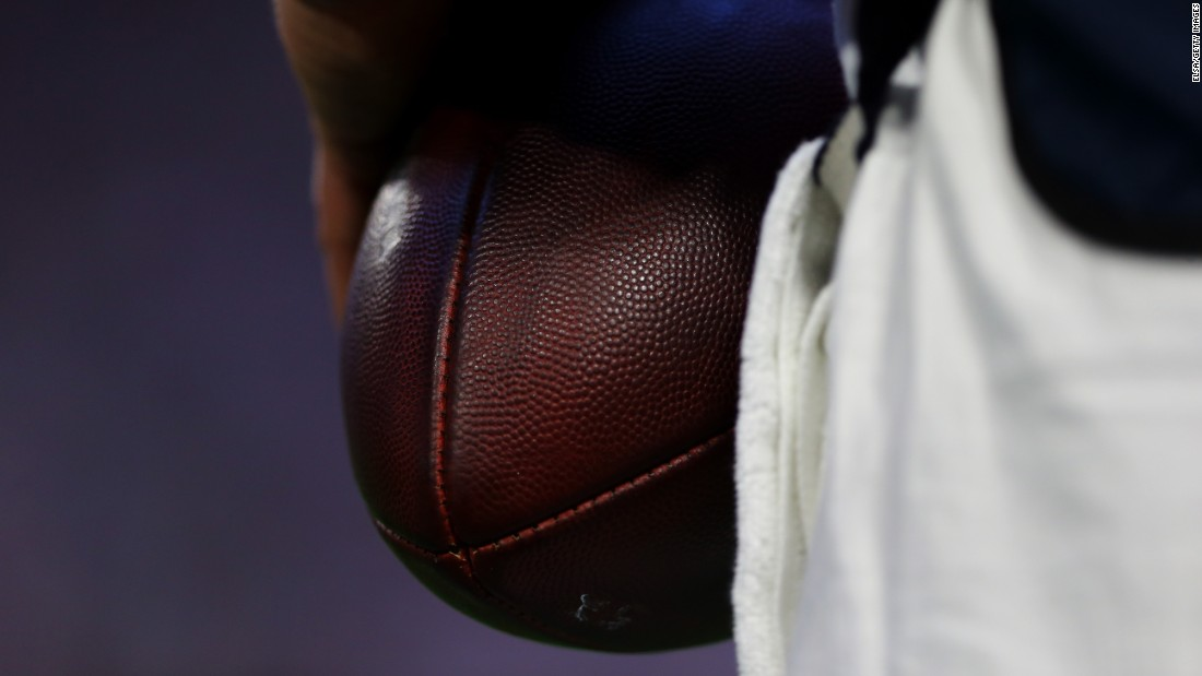 A closeup of a football during the game.