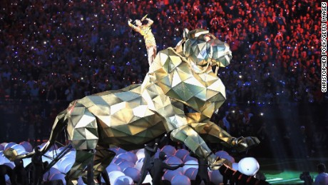 Katy Perry took a literal approach to 'Roar' as her Super Bowl halftime show began.