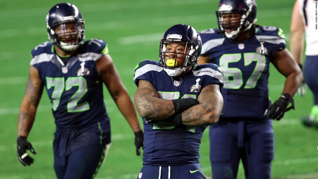 Seattle's Bruce Irvin, front, reacts after a sack on Brady.