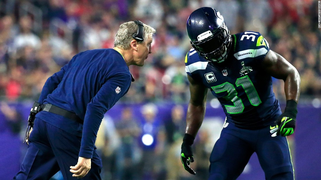 Seattle head coach Pete Carroll talks to Kam Chancellor in the second half.