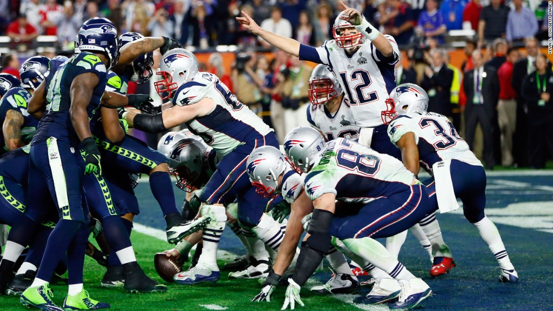 Brady signals late in the game as the Patriots run out the clock.