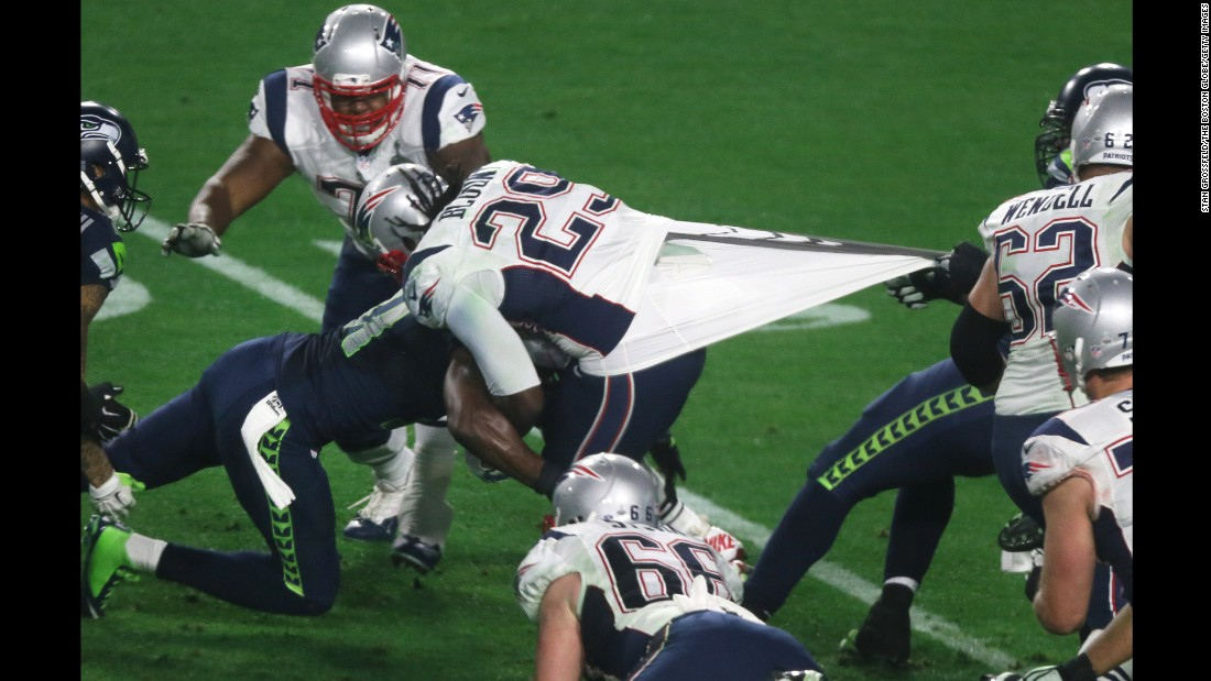 New England running back LeGarrette Blount has his jersey pulled during the fourth quarter.