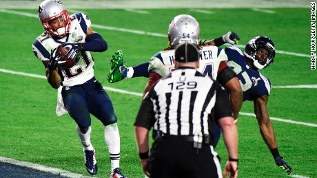 Caption:GLENDALE, AZ - FEBRUARY 01: Malcolm Butler #21 of the New England Patriots makes an interception against the Seattle Seahawks in the fourth quarter during Super Bowl XLIX at University of Phoenix Stadium on February 1, 2015 in Glendale, Arizona. (Photo by Harry How/Getty Images)
