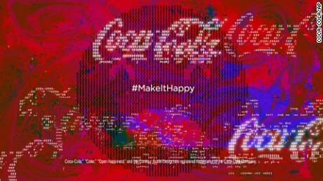 This image provided by Coca-Cola shows a portion of a television ad the company is scheduled to run during Super Bowl XLIX on Sunday, Feb. 1, 2015. (AP Photo/Coca-Cola)