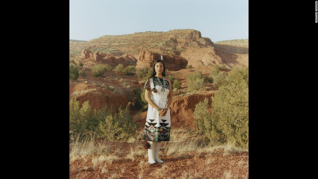Juanita Toledo, 28, works for the community wellness program on her reservation in New Mexico. Here, she wears traditional dress and moccasins made by her family.