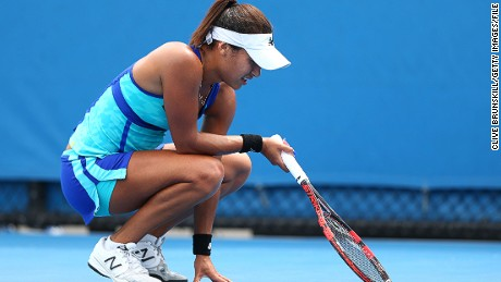 Heather Watson crouches during the Australian Open match which she says was affected by her period.