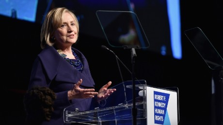 Caption:NEW YORK, NY - DECEMBER 16: Honoree Hillary Rodham Clinton speaks onstage at the RFK Ripple Of Hope Gala at Hilton Hotel Midtown on December 16, 2014 in New York City. (Photo by Mike Coppola/Getty Images for RFK Ripple Of Hope)