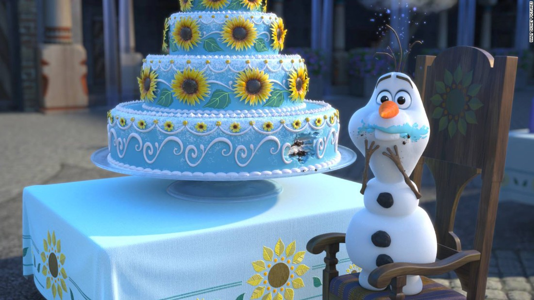 "Snowman Olaf, ""Frozen's"" comic relief, can't resist sneaking an early bite of birthday cake."