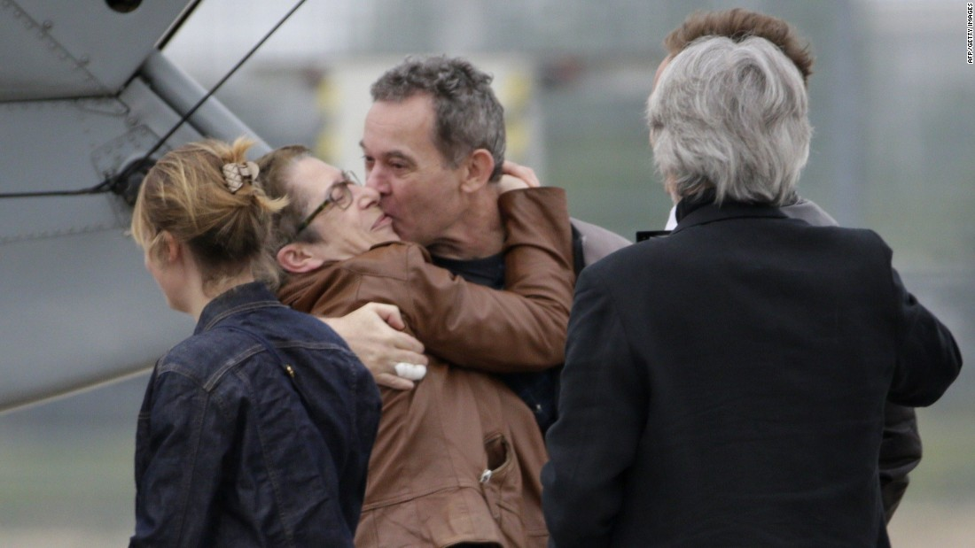 François celebrates with his family upon his release.