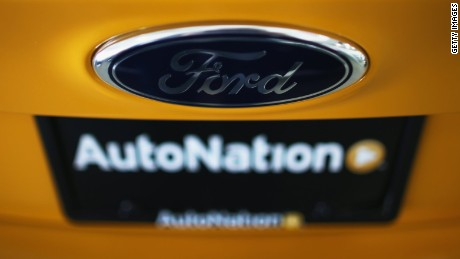 A Ford emblem is seen on the hood of a car at a Ford AutoNation car dealership on September 4, 2013 in North Miami, Florida.
