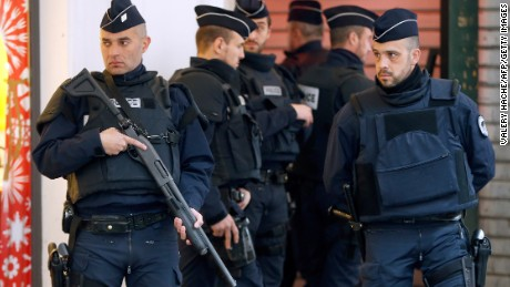 Security Police Forces stand guard outside the Jewish Community Center where three soldiers, patrolling outside the center as part of the country's Vigipirate security measures, were attacked by a man with a bladed weapon, on February 3, 2015 in downtown Nice, southeastern France.