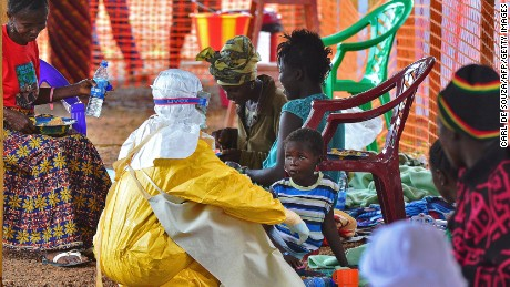 Although the Ebola outbreak reached 9 countries (with the epicentre in three countries), it has not reached pandemic proportions and remains defined as an outbreak. Here, an MSF medical worker feeds an Ebola child victim at an MSF facility in Kailahun, Sierra Leone.