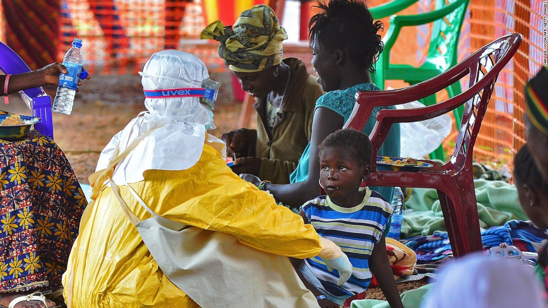 A medical worker feeds an Ebola victim at a Doctors Without Borders facility in Kailahun, Sierra Leone. There were hundreds of volunteers from all around the world who answered the call to help the people at the heart of the epidemic.