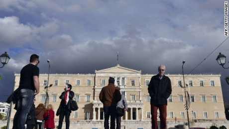 "People stand in front of the Greek parliament in Athens on February 2, 2015. EU Commission chief Jean-Claude Juncker backs a change to the ""troika"" mission, the much-loathed team tasked with enforcing Greece's international bailout, his spokesman said Monday.The new leftist government led by Prime Minister Alexis Tsipras has demanded an end to the oversight system, which groups the International Monetary Fund, European Commission and European Central Bank, and is widely loathed by austerity-hit Greeks. AFP PHOTO / LOUISA GOULIAMAKILOUISA GOULIAMAKI/AFP/Getty Images"