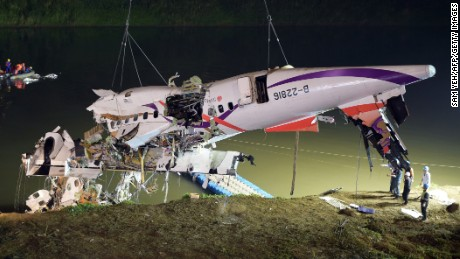 The wreckage of the TransAsia Flight GE235 is lifted from the Keelung River in Taipei, Taiwan, on February 4.