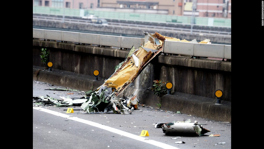 Debris from the plane sits on the bridge in Taipei on February 4.