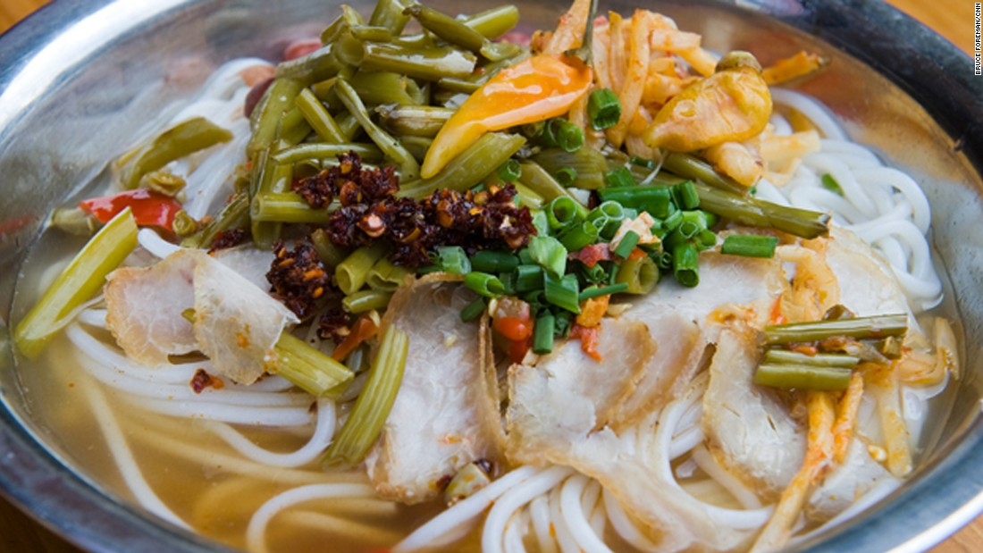 Guilin isn't only famous for its heavenly landscape, but also bowls of rice noodles topped with preserved long beans, peanuts, bamboos shoots and spring onions.