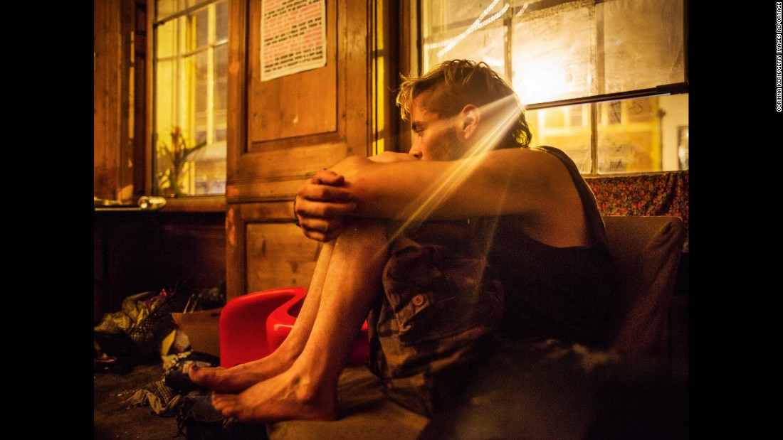 "A squatter sits in the living room of a London squat called ""Borough High Street."" Photographer Corinna Kern visited several squats in the capital city."