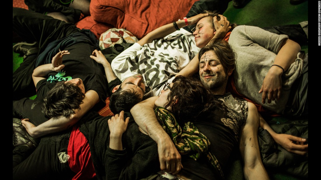 "Residents lie together in the London squat called ""Borough High Street."" The communal squatting lifestyle often creates strong bonds and a family feeling among the residents."