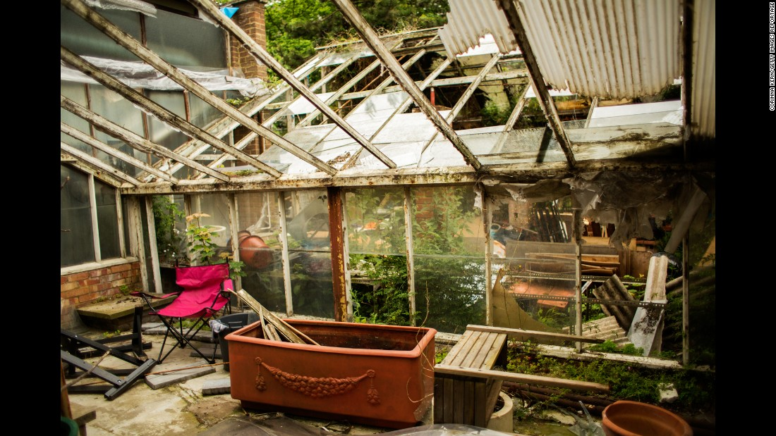 "An abandoned greenhouse sits in a squat called ""Garden Centre."""