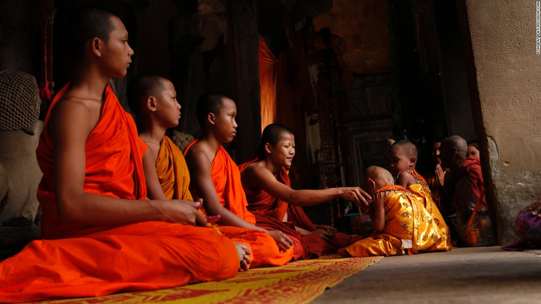 Monks from the nearby temple can often be seen conducting Buddhist ceremonies inside Angkor Wat.