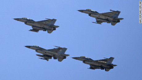 Jordanian Air Force fighter jets fly during the funeral of slain Jordanian pilot Lt. Moath al-Kasasbeh at his home village near Karak, Jordan on February 4.