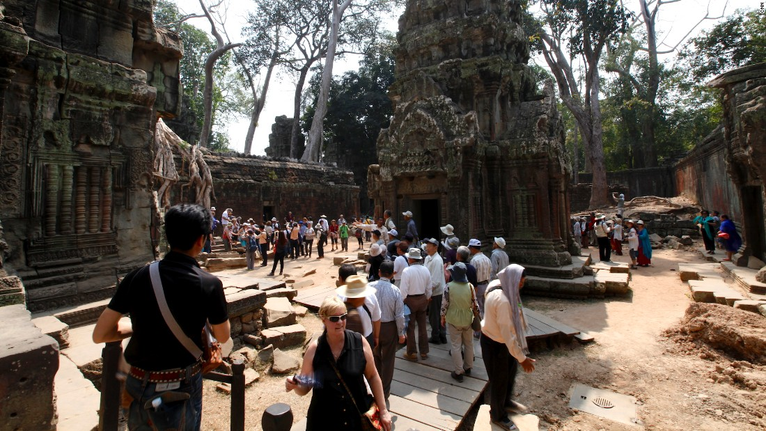"You didn't think you'd have the place to yourself, did you? Thanks to a little-known actress called Angelina Jolie and the film ""Tomb Raider,"" this Angkor temple, famed for the large fig, banyan and kapok trees that are 'choking' the ruins, endures the bulk of visitors to the area."