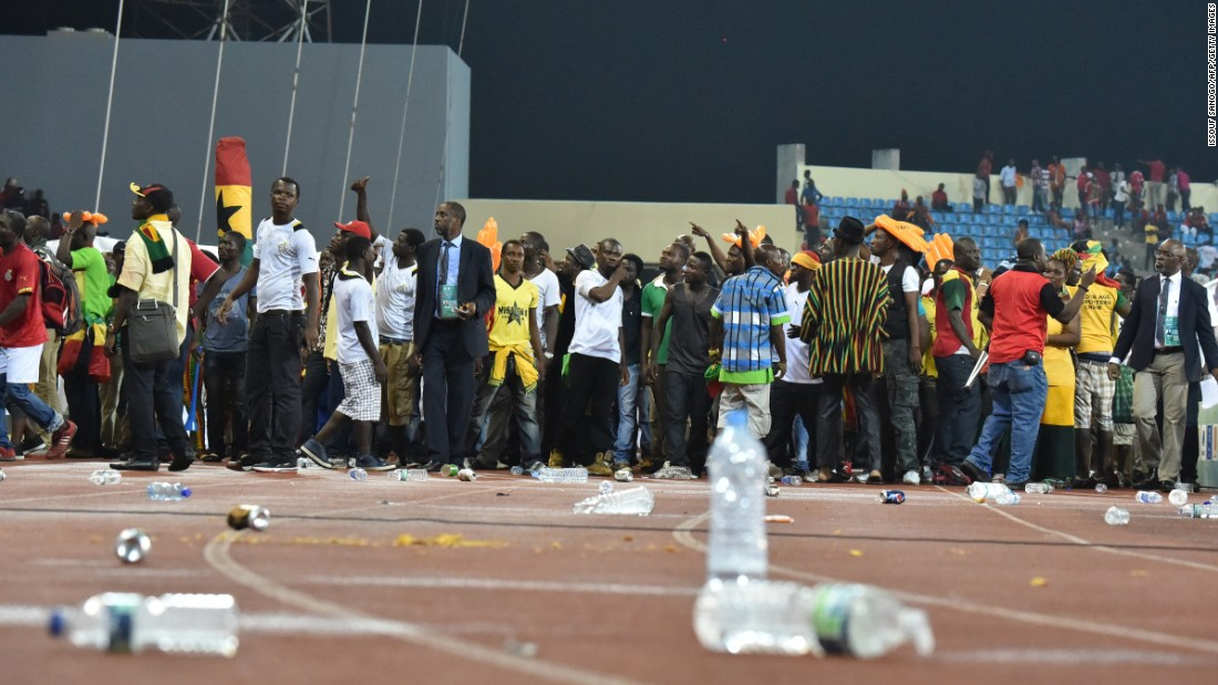 Ghana supporters try to get out of the stadium. Ghana won 3-0, but the game will be remembered for the crowd trouble.