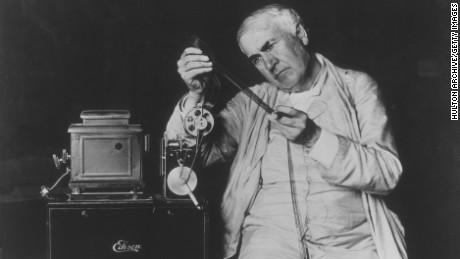 circa 1900:  American inventor Thomas Alva Edison (1847 - 1931) examining motion picture film threaded through one of his film projectors.  (Photo by )