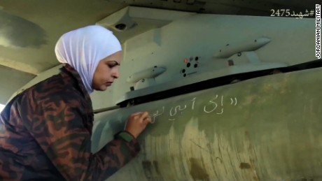 "The Jordanian military released this a video of women loading bombs on their planes, ""from the people of Jordan"" they wrote in chalk."