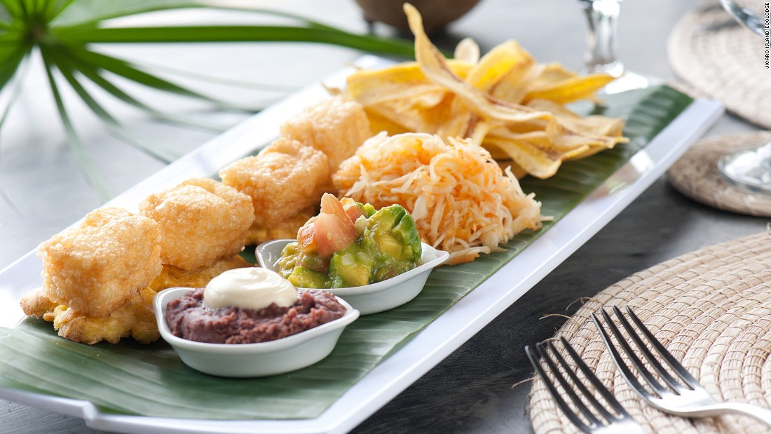 """""""Bunuelos de yuca y queso"""" are deep-fried fritters that contain yuca and salty white cheese. The popular dish (served here at the Jicaro Island Ecolodge) is usually served with guacamole and mashed beans."""